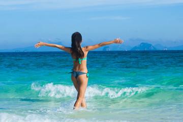 Happy girl walking to sea