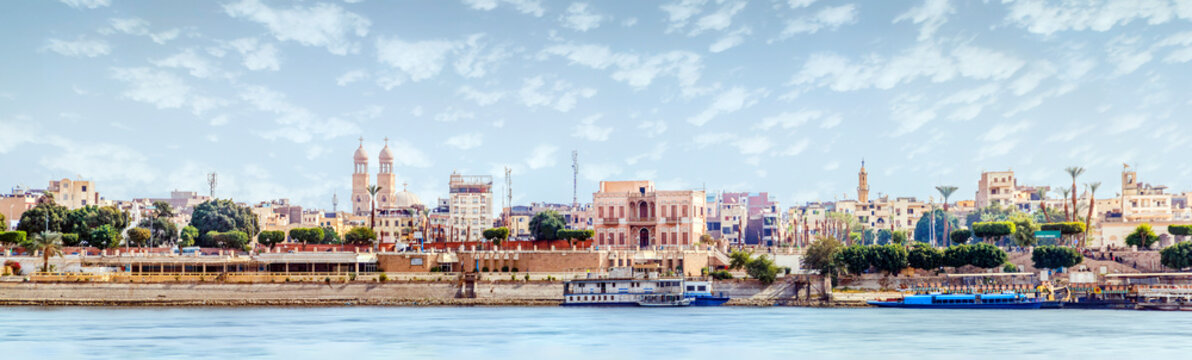 Aswan, Egypt, view of the panorama of the city from the mountain of the west coast of the Nile on a sunny day