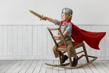 Little boy plays the knight