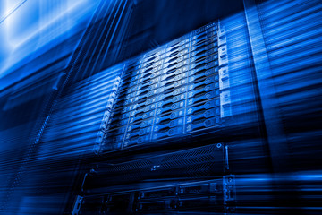 Point of bottom view of array disk storage in data center with depth of field in cool blue tone