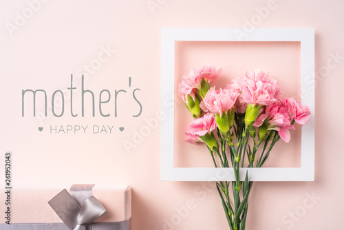 top view of carnation on pink for mothers day
