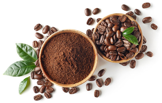 Bowl of ground coffee and beans isolated on white background