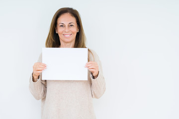 Wall Mural - Middle age woman holding blank paper sheet over isolated background with a happy face standing and smiling with a confident smile showing teeth