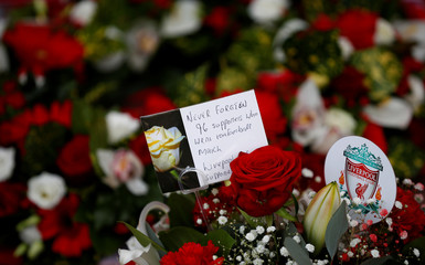 Floral tributes are left at the Hillsborough Memorial on the 30th anniversary of the Hillsborough disaster when 96 Liverpool supporters were crushed to death at the 1989 FA Cup semi-final football match between Liverpool and Nottingham Forest, outside Live