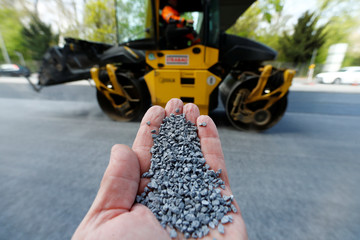 Titanium dioxide granulate, used in asphalt which reduces car emissions, is seen in this illustration picture