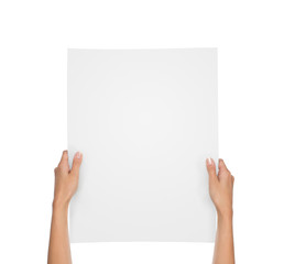 Close up of female hands holding blank paper sheet isolated on white background with copy space