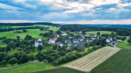 Aerial view of Schemmerhausen, a small village in the county of Reichshof in Germany. Wall mural