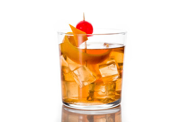 Old fashioned cocktail with orange and cherry isolated on white background Wall mural