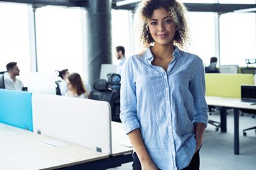 Modern young African business woman in the office with copy space.