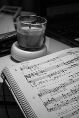 Black and white candle and music notes