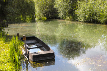 Small boat in marshes in Bourges