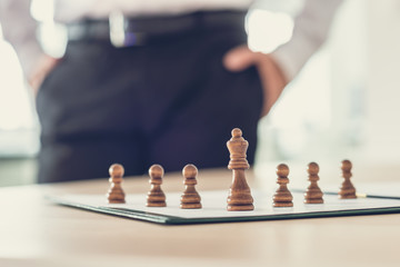 Chess pieces of king and pawns on a business document
