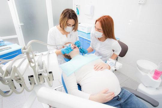 pregnant woman in dentist office, dental treatment for pregnant women