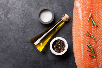 Raw salmon fish fillet and ingredients