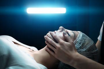 beautiful cosmetologist woman makes cometology procedure