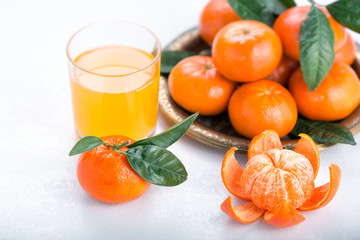 Juicy mandarins with green leaves