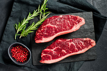 Garden Poster Steakhouse Steak of marbled beef black Angus. Black background, top view.