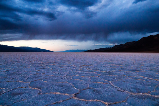 A rare sight, rain falling over Badwater Basin, Death Valley National Park, California. At -282 feet below sea level it is the lowest point in North America. The valley averages less than 2.5 inches of rain a year.
