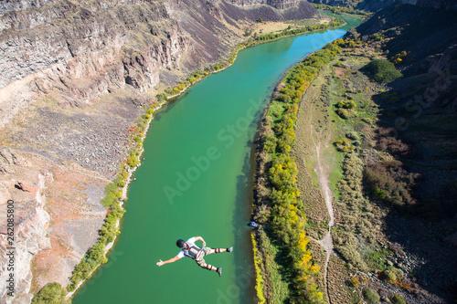 A Base Jumper Leaps Off The 486 Foot Perrine Bridge In Twin Falls