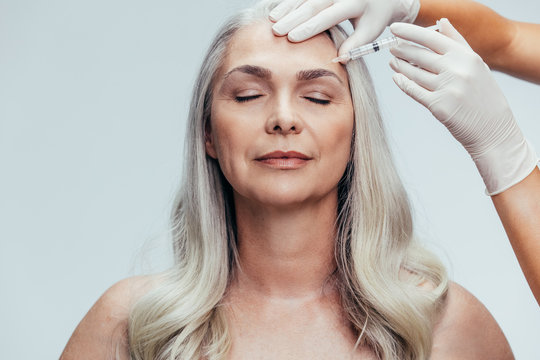 Senior woman getting cosmetic injection