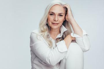 Pretty senior woman in white casuals