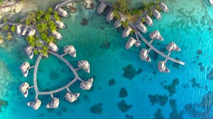Fototapeta TOP DOWN Spectacular drone shot of exotic island landscape and rich hotel resort obraz