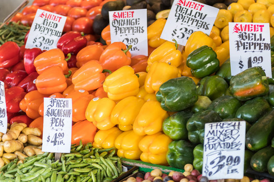 Colorful and varied peppers in a stand at the Pike Place Market in Seattle.