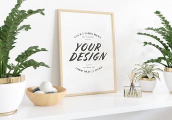 Vertical Frame Leaning on Shelf with Plants Mockup