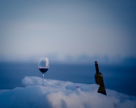 bottle of wine and glass in winter