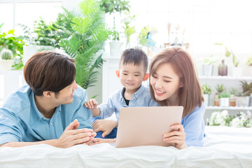 Parent play laptop with child