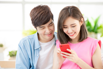 Pregnant couple use smart phone