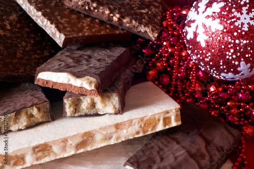 Traditional Spanish Christmas candy. Turron and nougat with nuts. Christmas tree decorations in the