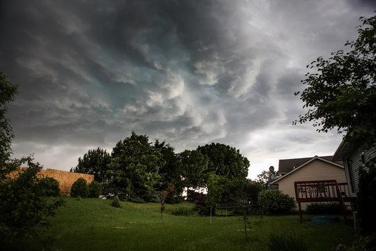 Thunderstorm clouds over a suburban neighborhood