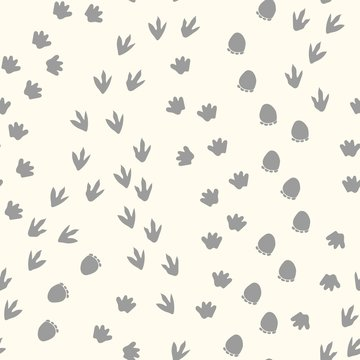 Seamless repeat pattern with dinosaur tracks