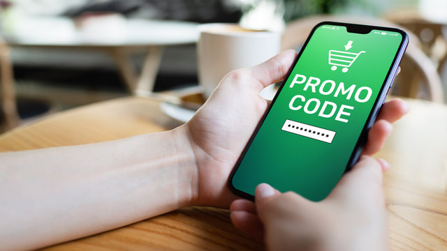 Promo code Discount coupon number field on mobile phone screen. Business and marketing concept.