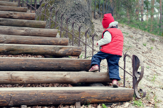 the boy himself climbs the steep stairs
