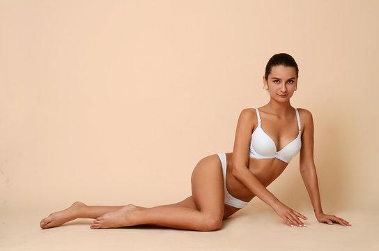 Fashion portrait of a professional model in white sexy underwear