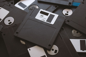 blank floppy disks with soft-focus and over light in the background