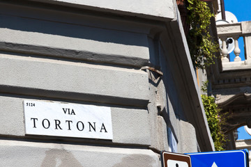 Milan, street sign, Via Tortona - marble panel with the road name. Tortona district important for the fashion and design sectors, Lombardy Italy