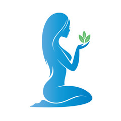 beautiful woman holding a plant ina a palm, heath care concept