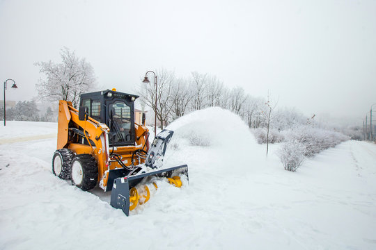 Snow removal works, snow removal machine in action