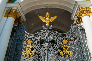 Winter palace - decorated gates with double headed eagle at the main entrance of the Winter palace.St-Petersburg, Russia