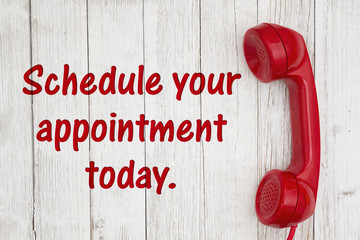 Schedule your appointment today text with retro red phone handset