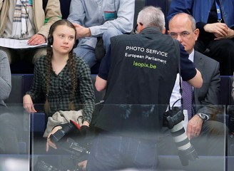 Swedish environmental activist Greta Thunberg attends a voting session in the tribune of the European Parliament in Strasbourg