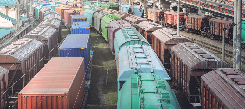 Railway wagons with cargo of metal and grain in port of Odessa. trains are waiting in line for loading at cargo terminal. most economical logistics solutions for rail transport