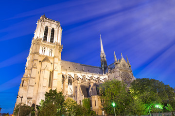 Notre Dame Cathedral facade against a beautiful blue sky at night, Paris - France
