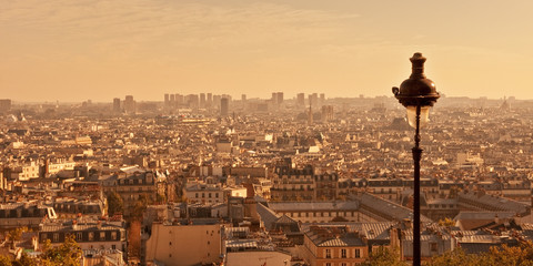 Fototapete - Aerial view of Paris from Montmartre hill at sunset, France