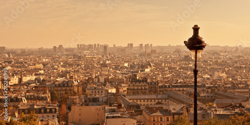 Wall mural Aerial view of Paris from Montmartre hill at sunset, France