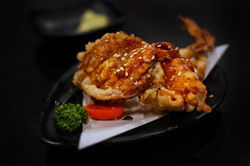 Japanese food: Crab Tempura served with Japanese cooked rice on table. Clean food concept. Toned image. Selective focus and free space for text.