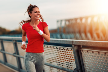 Young fitness woman running outdoors